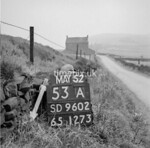 SD960253A, Man marking Ordnance Survey minor control revision point with an arrow in 1950s