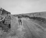 SD960085B, Man marking Ordnance Survey minor control revision point with an arrow in 1950s