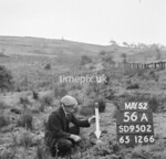 SD950256A, Man marking Ordnance Survey minor control revision point with an arrow in 1950s