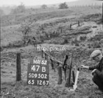 SD950247B, Man marking Ordnance Survey minor control revision point with an arrow in 1950s