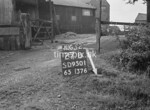SD950127B1, Man marking Ordnance Survey minor control revision point with an arrow in 1950s