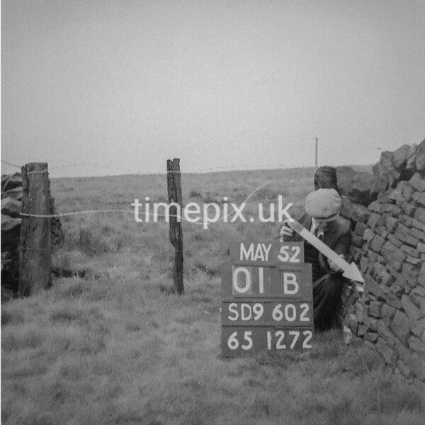 SD960201B, Man marking Ordnance Survey minor control revision point with an arrow in 1950s