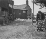 SD950127W, Man marking Ordnance Survey minor control revision point with an arrow in 1950s