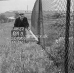 SD950084B, Man marking Ordnance Survey minor control revision point with an arrow in 1950s