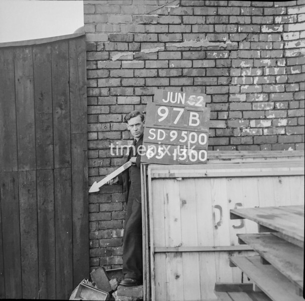 SD950097B, Man marking Ordnance Survey minor control revision point with an arrow in 1950s