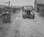 SD960086A, Man marking Ordnance Survey minor control revision point with an arrow in 1950s