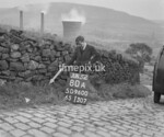 SD960080A, Man marking Ordnance Survey minor control revision point with an arrow in 1950s