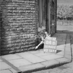 SD960284B, Man marking Ordnance Survey minor control revision point with an arrow in 1950s