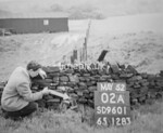 SD960102A, Man marking Ordnance Survey minor control revision point with an arrow in 1950s