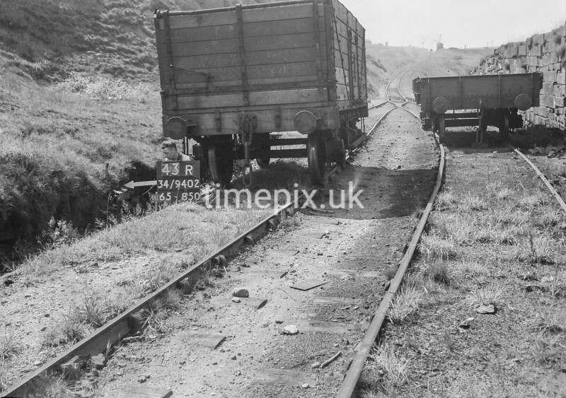 SD940243R, Man marking Ordnance Survey minor control revision point with an arrow in 1950s