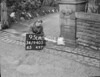 SD940595A, Man marking Ordnance Survey minor control revision point with an arrow in 1950s