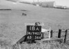 SD940718A, Man marking Ordnance Survey minor control revision point with an arrow in 1950s