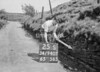 SD940725S, Man marking Ordnance Survey minor control revision point with an arrow in 1950s