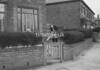SD940521A, Man marking Ordnance Survey minor control revision point with an arrow in 1950s