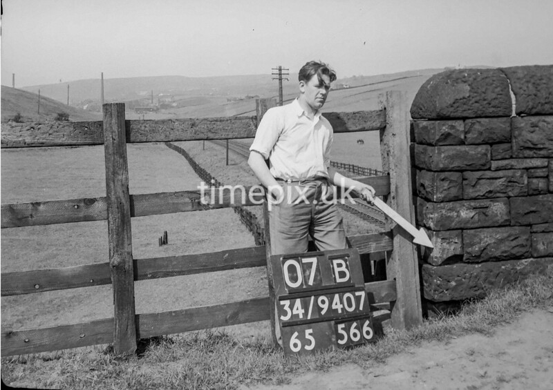 SD940707B, Man marking Ordnance Survey minor control revision point with an arrow in 1950s