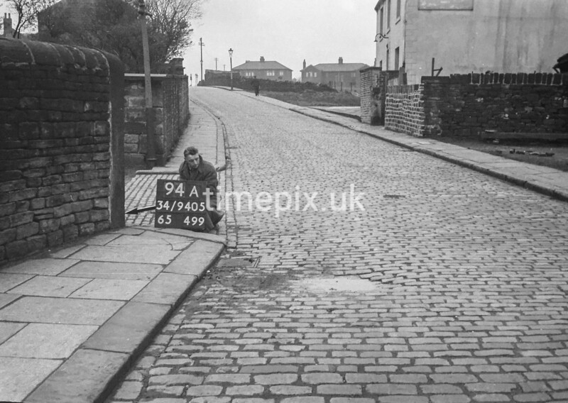 SD940594A, Man marking Ordnance Survey minor control revision point with an arrow in 1950s