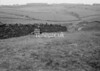 SD940722A, Man marking Ordnance Survey minor control revision point with an arrow in 1950s