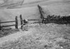 SD940639B, Man marking Ordnance Survey minor control revision point with an arrow in 1950s