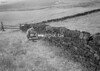 SD940639A, Man marking Ordnance Survey minor control revision point with an arrow in 1950s