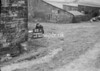 SD940713A, Man marking Ordnance Survey minor control revision point with an arrow in 1950s