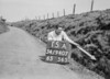 SD940715A, Man marking Ordnance Survey minor control revision point with an arrow in 1950s