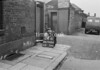SD940624B, Man marking Ordnance Survey minor control revision point with an arrow in 1950s