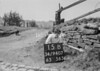 SD940715B, Man marking Ordnance Survey minor control revision point with an arrow in 1950s