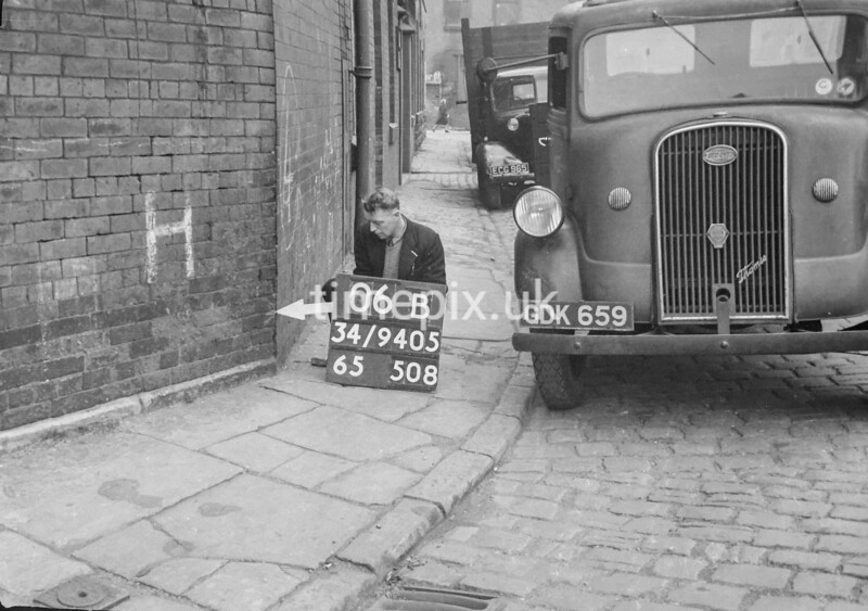 SD940506B, Man marking Ordnance Survey minor control revision point with an arrow in 1950s