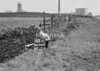 SD940783A, Man marking Ordnance Survey minor control revision point with an arrow in 1950s