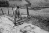 SD940628K, Man marking Ordnance Survey minor control revision point with an arrow in 1950s