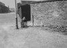 SD940507B, Man marking Ordnance Survey minor control revision point with an arrow in 1950s