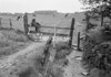SD940628B, Man marking Ordnance Survey minor control revision point with an arrow in 1950s