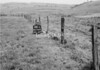 SD940700A, Man marking Ordnance Survey minor control revision point with an arrow in 1950s