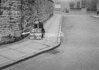 SD940521L, Man marking Ordnance Survey minor control revision point with an arrow in 1950s