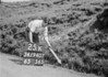 SD940725K, Man marking Ordnance Survey minor control revision point with an arrow in 1950s
