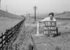 SD940718B, Man marking Ordnance Survey minor control revision point with an arrow in 1950s