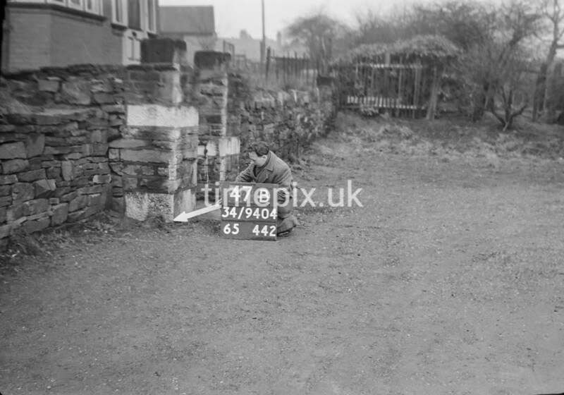 SD940447B, Man marking Ordnance Survey minor control revision point with an arrow in 1950s
