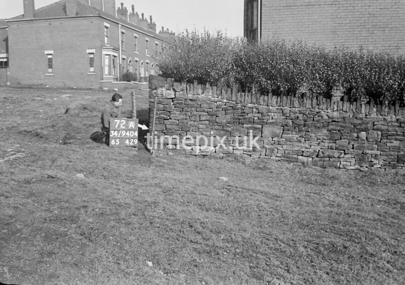 SD940472A, Man marking Ordnance Survey minor control revision point with an arrow in 1950s