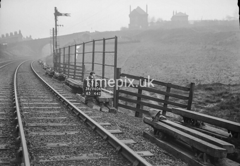 SD940467B, Man marking Ordnance Survey minor control revision point with an arrow in 1950s