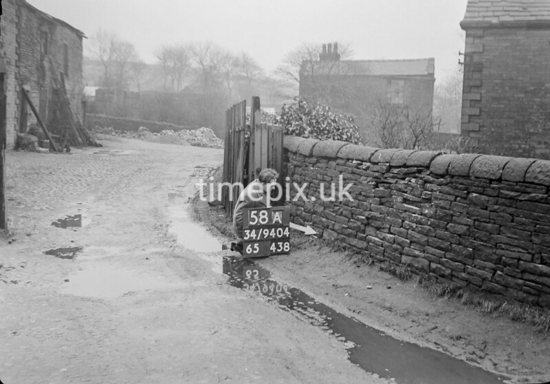 SD940458A, Man marking Ordnance Survey minor control revision point with an arrow in 1950s