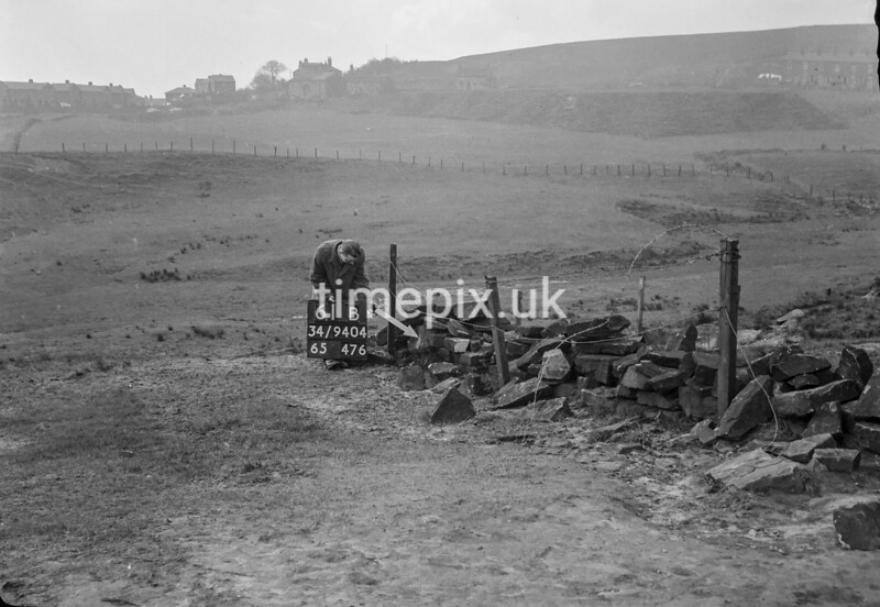 SD940461B, Man marking Ordnance Survey minor control revision point with an arrow in 1950s