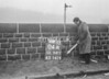 SD941104A, Man marking Ordnance Survey minor control revision point with an arrow in 1950s