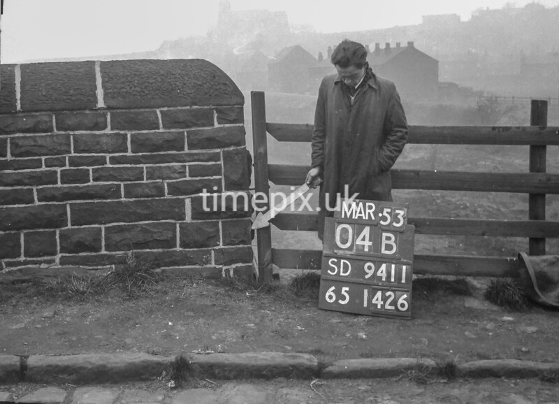 SD941104B, Man marking Ordnance Survey minor control revision point with an arrow in 1950s