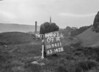 SD941109A, Man marking Ordnance Survey minor control revision point with an arrow in 1950s
