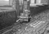 SD941120L, Man marking Ordnance Survey minor control revision point with an arrow in 1950s