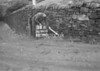 SD941033B, Man marking Ordnance Survey minor control revision point with an arrow in 1950s