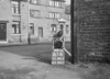 SD941107A, Man marking Ordnance Survey minor control revision point with an arrow in 1950s