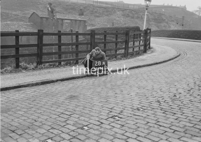 SD941028A, Man marking Ordnance Survey minor control revision point with an arrow in 1950s