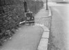 SD940952A, Man marking Ordnance Survey minor control revision point with an arrow in 1950s