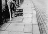 SD940919A, Man marking Ordnance Survey minor control revision point with an arrow in 1950s